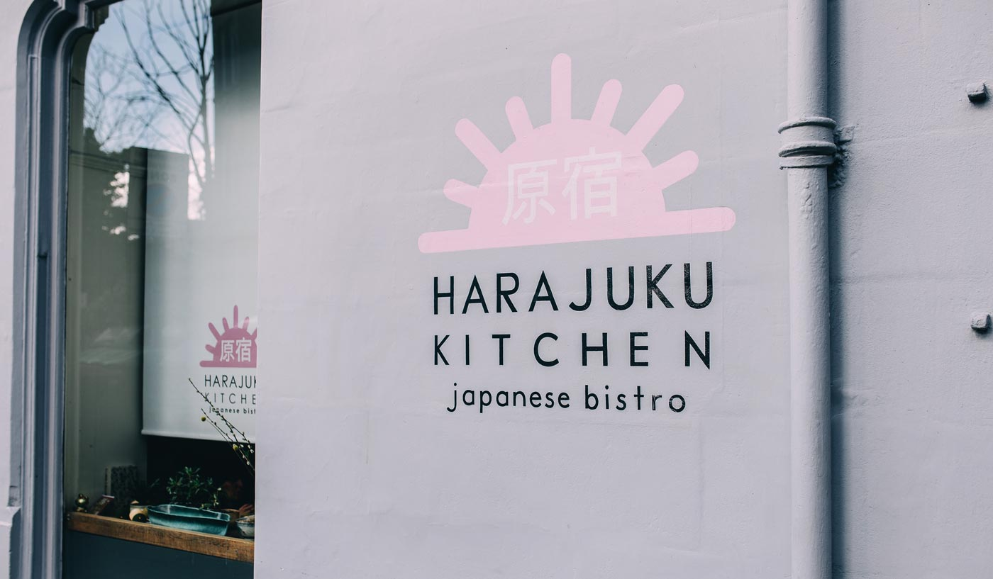 Harajuku Kitchen Japanese restaurant branding on exterior wall